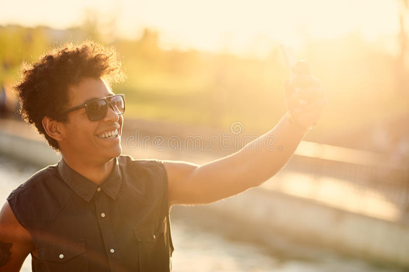 Stylish african american young man making a selfie royalty free stock photo