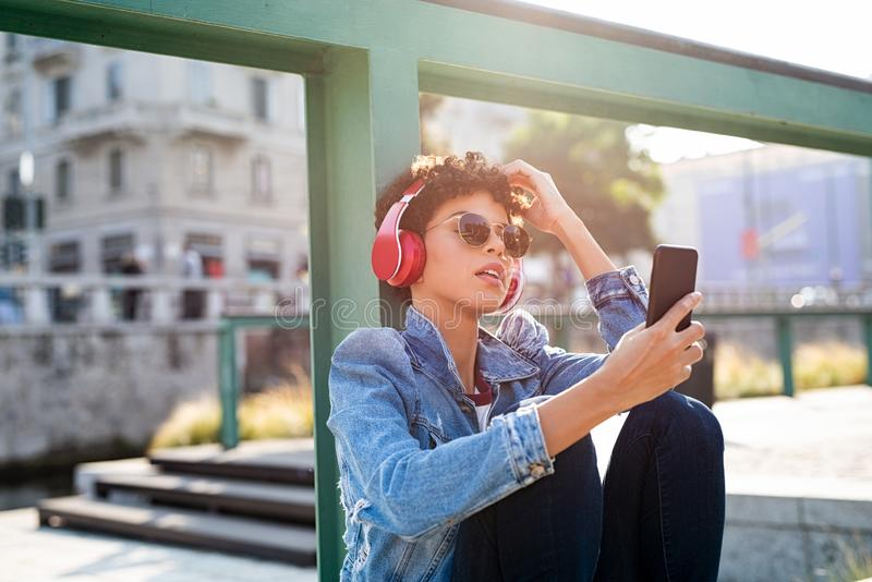 Stylish african woman listening music stock images