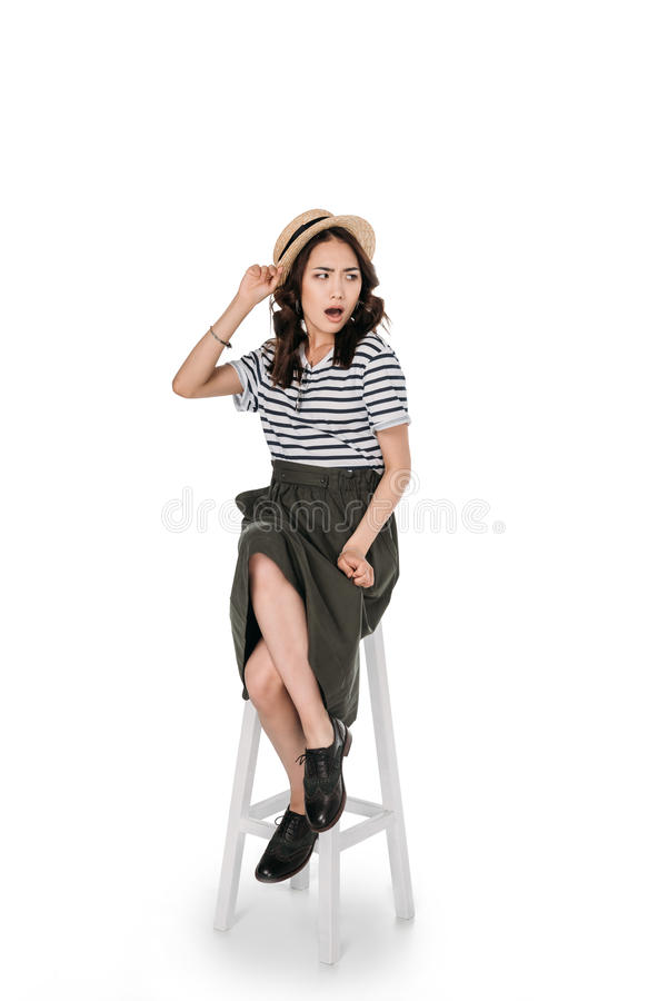 Free Stylish Asian Girl With Facial Expression Sitting On Chair Stock Photography - 97083842