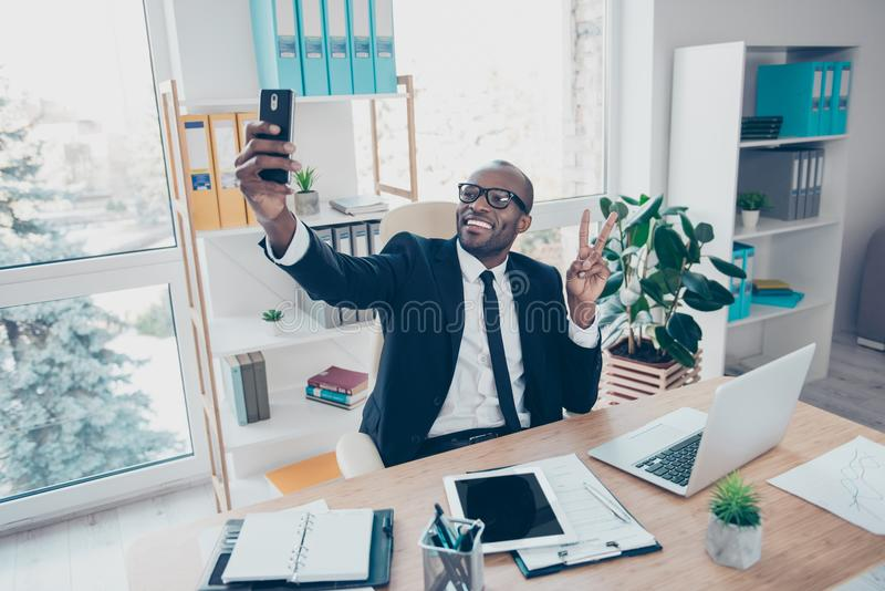 Stylish attractive, modern, cheerful man shooting self picture o stock images