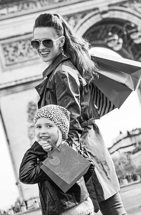 Happy modern mother and child shopper in Paris, France royalty free stock images