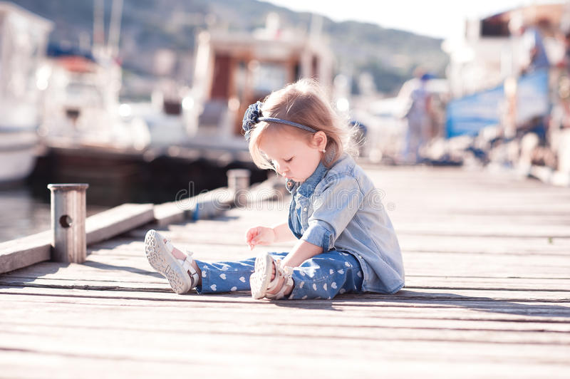 Stylish baby girl plsying outdoors royalty free stock photos