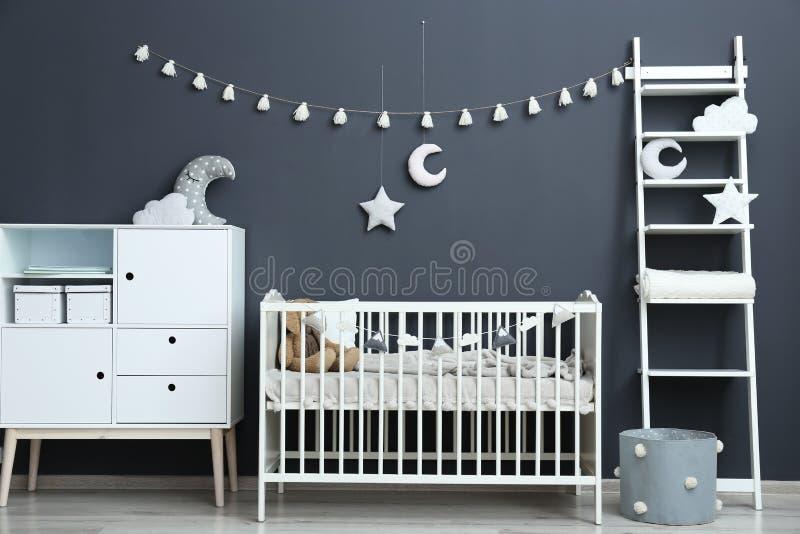 Stylish baby room interior with crib. Stylish baby room interior with comfortable crib royalty free stock images