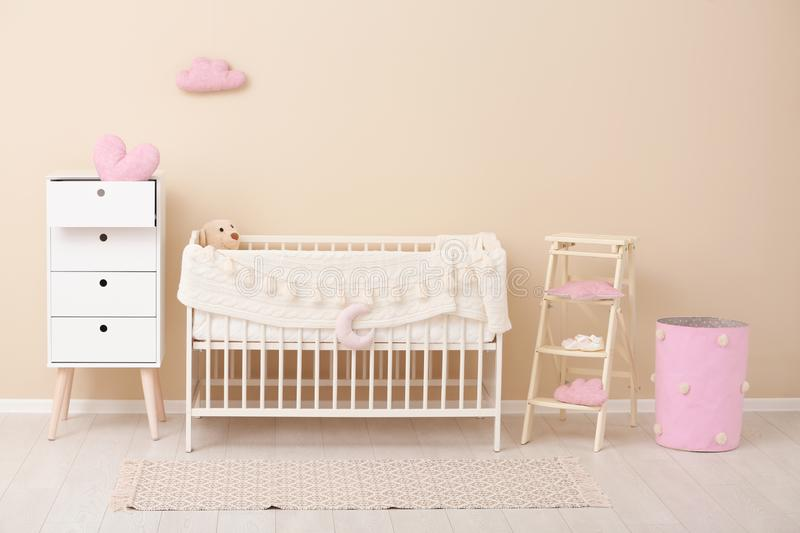 Stylish baby room interior with crib royalty free stock image