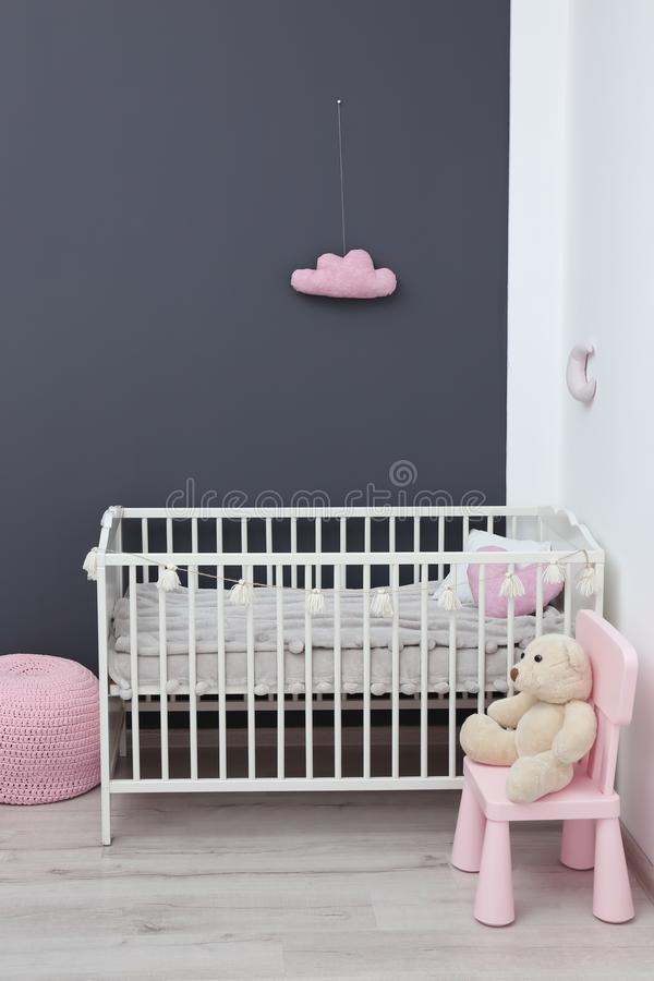 Stylish baby room interior with crib stock image