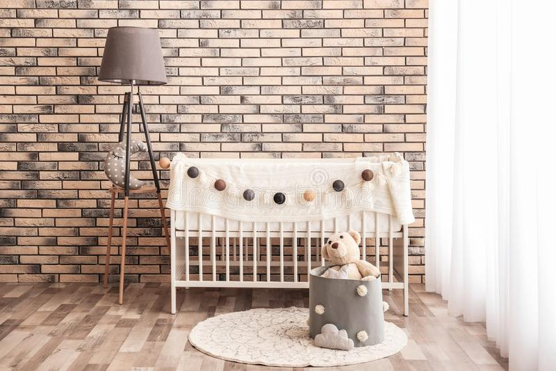 Stylish baby room interior with crib. Stylish baby room interior with comfortable crib stock photo