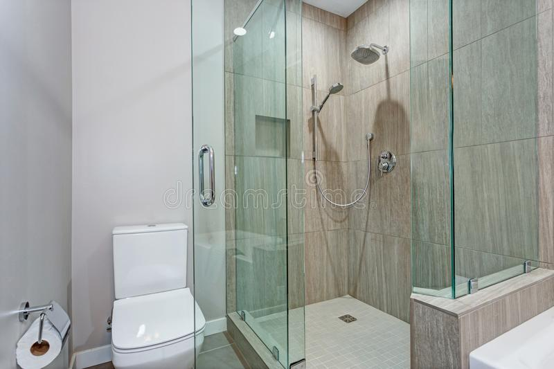 Stylish bathroom interior with glass walk in shower royalty free stock photo