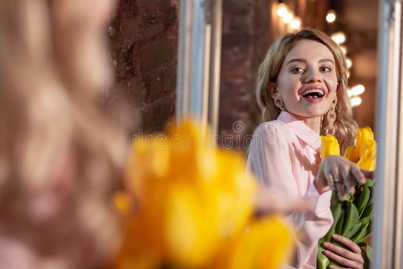Stylish beaming blonde woman feeling happy after romantic date royalty free stock photography