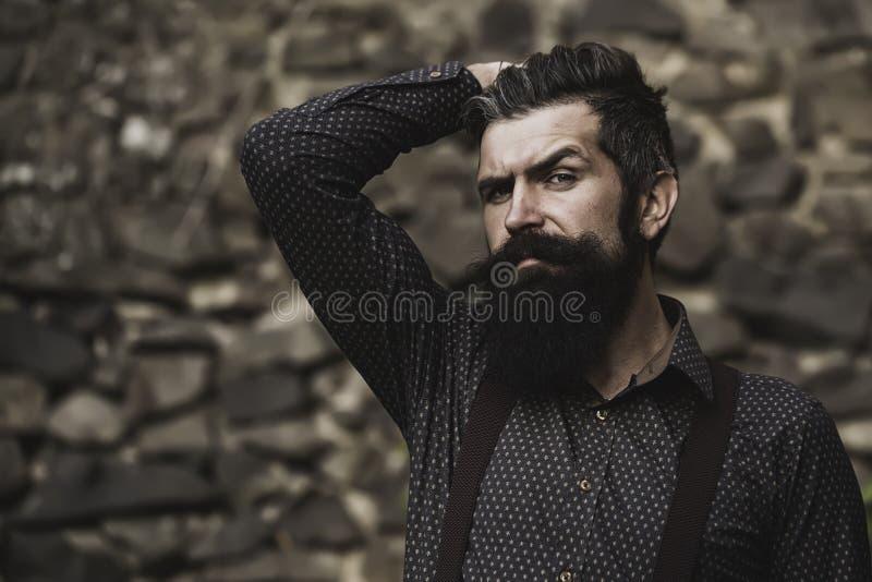 Stylish bearded man outdoor stock photos