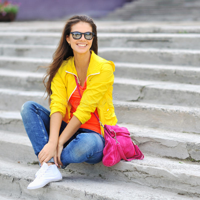 Stylish beautiful girl in colorful clothes wearing sunglasses royalty free stock photos