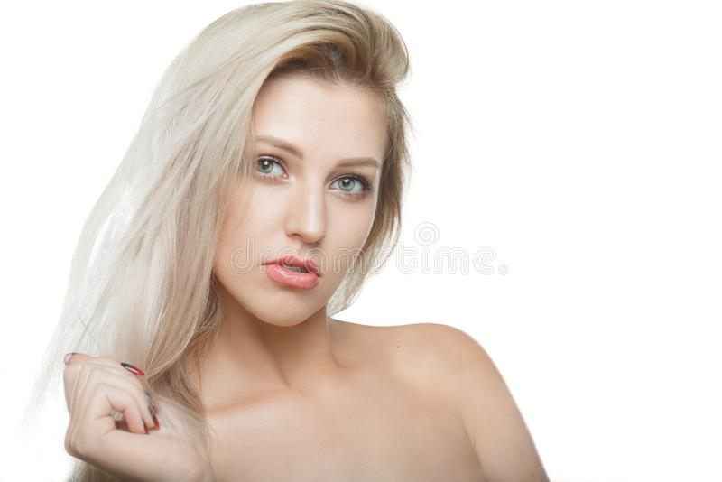 Stylish beautiful girl with flowing hair looking at camera with joyful happy facial expression stock photography