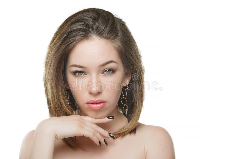 Stylish beautiful girl with flowing hair looking at camera with joyful happy facial expression stock photos