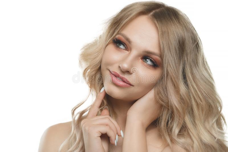Stylish beautiful girl with flowing hair looking at camera with joyful happy facial expression stock image