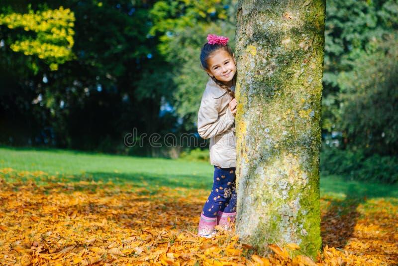 Stylish beautiful girl having fun in the park on sunny autumn day royalty free stock photos