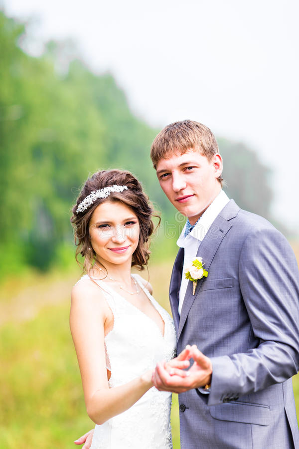 Stylish beautiful happy bride and groom in the royalty free stock photo