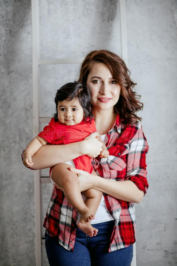 Stylish beautiful mommy rejoicing at her happy motherhood stock photo