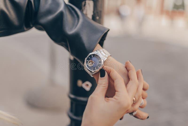 Stylish beautiful silver watch on woman hand stock image