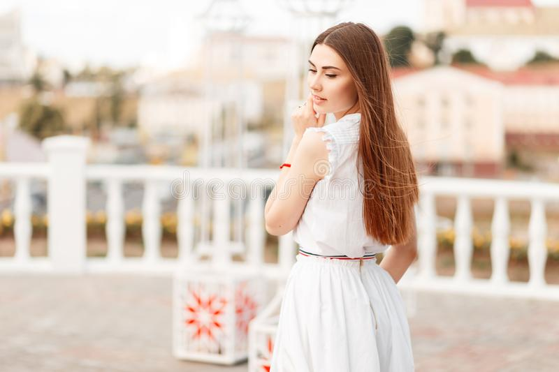 Stylish beautiful young model woman in white fashion dress stock photos