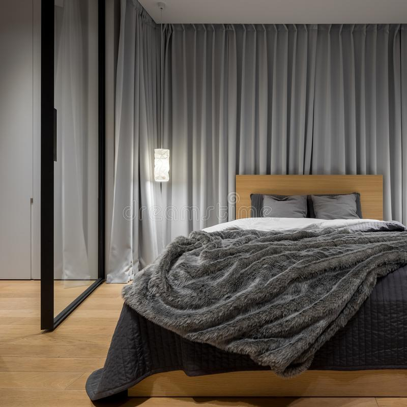 Stylish bedroom with double bed stock photos