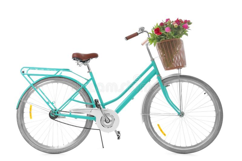 Stylish bicycle with basket and flowers stock photography