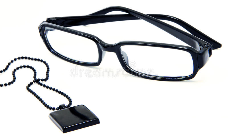 Stylish Black Glasses And Pendant With Ball Chain Stock Image