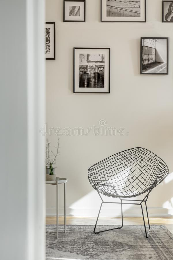 Stylish metal chair in classy white living room interior with tenement house. Stylish black metal chair in classy white living room interior with tenement house stock images