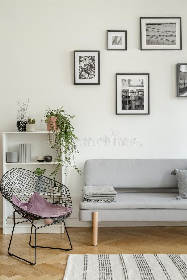 Free Stylish Black Metal Chair In Classy White Living Room Interior With Tenement House Stock Images - 152145664
