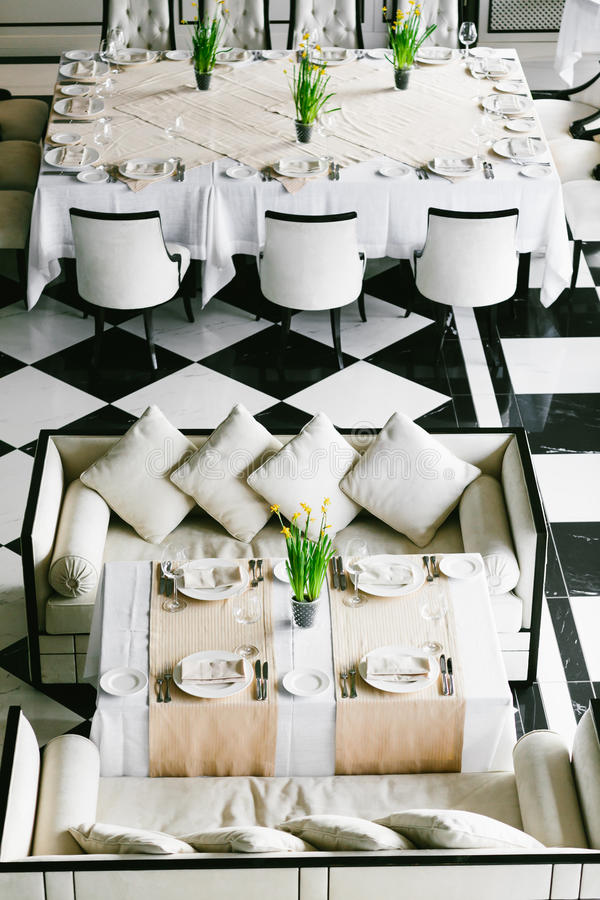 Stylish black and white dining tables and chairs. Minimalist interior in monochrome. Empty restaurant top view. stock images