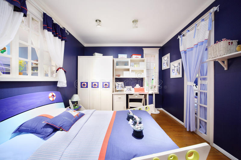 Stylish Blue Bedroom For Boy Royalty Free Stock Photography
