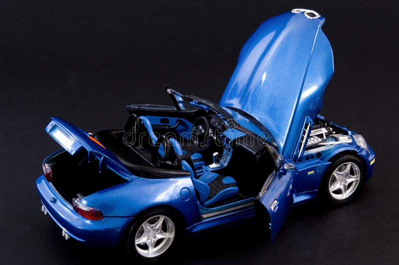 Stylish blue covertible roadster stock images