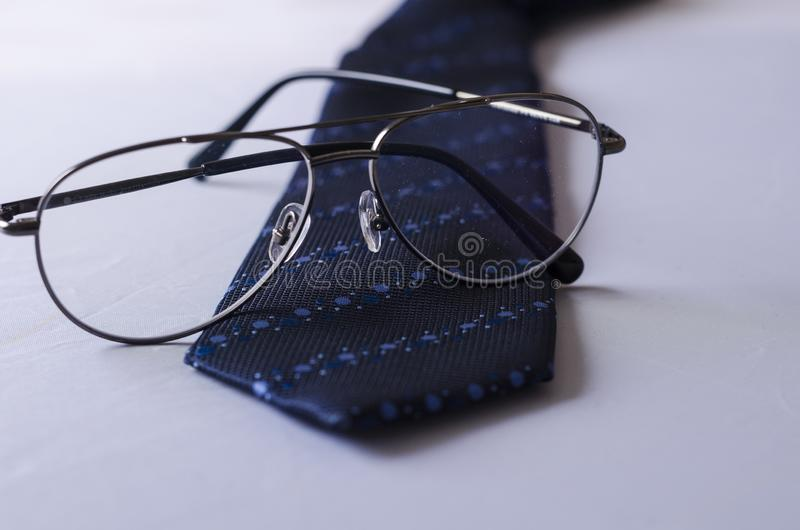 A Dotted Blue Tie with Spectacles stock photos