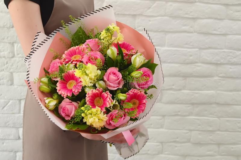 Stylish bouquet of pink flowers. stock photos