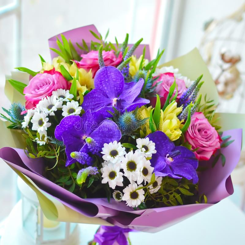 Stylish bouquet with roses and orchids royalty free stock photos