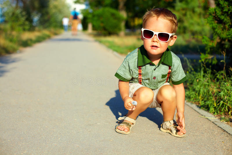Stylish boy in sunglasses, summer outdoors stock photography