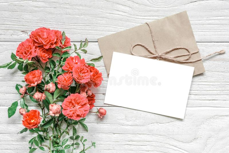 Stylish branding mockup to display your artworks. greeting card and rose flowers in Living Coral color stock photography