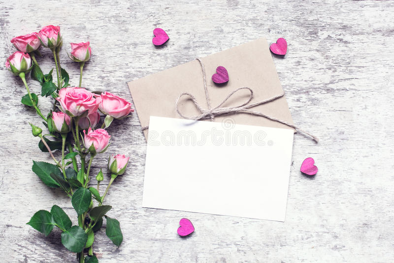 Stylish branding mockup to display your artworks. vintage toning. Stylish branding mockup to display your artworks. vintage wedding greeting card with pink roses stock image