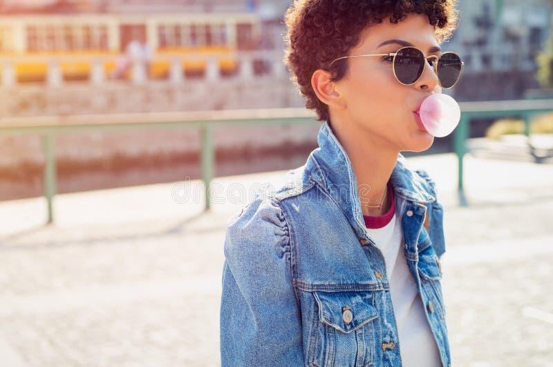 Stylish brazilian girl with bubble gum stock images