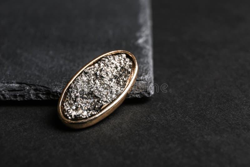Stylish brooch on black background. Luxury jewelry stock image