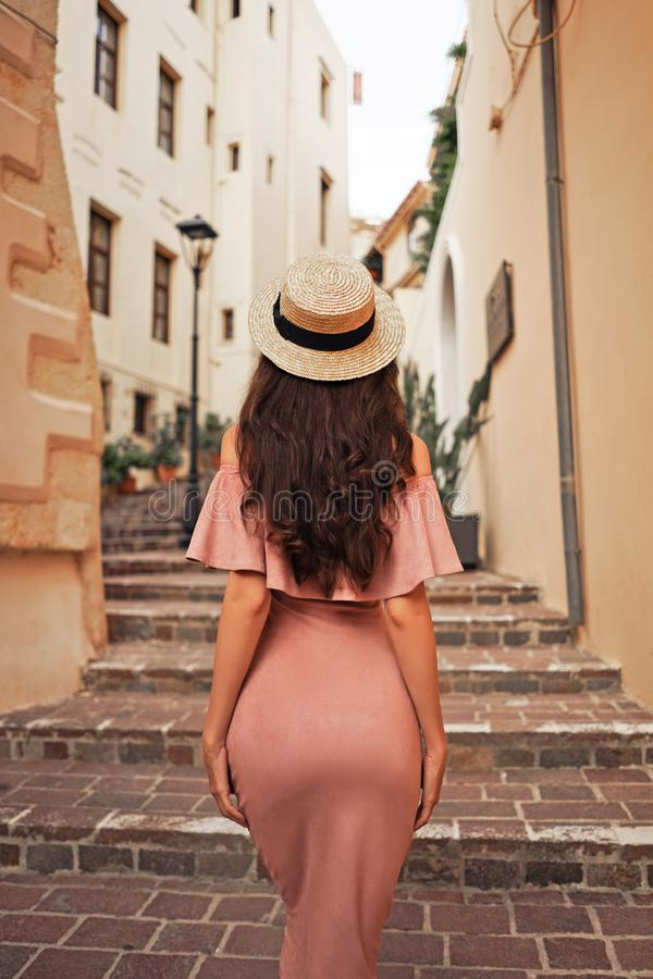 Stylish brunette woman walking in old town stock photos