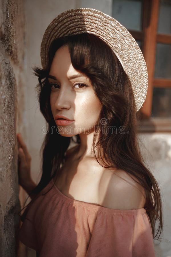 Stylish brunette woman walking in old town stock photography