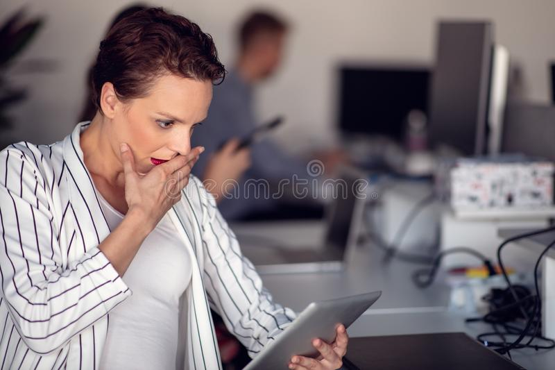 Stylish brunette working from home in her home office royalty free stock photography