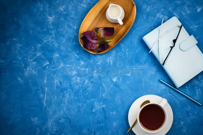 Stylish business flatlay mockup with cup of black tea, planner with glasses and pen, milk holder royalty free stock photos