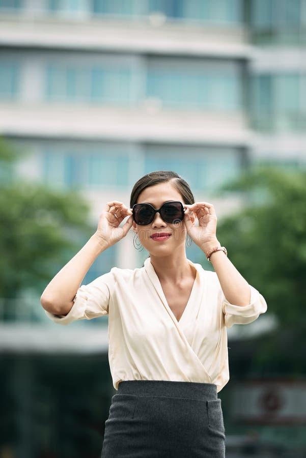 Stylish business lady. Portrait of beautiful business lady wearing sunglasses stock image