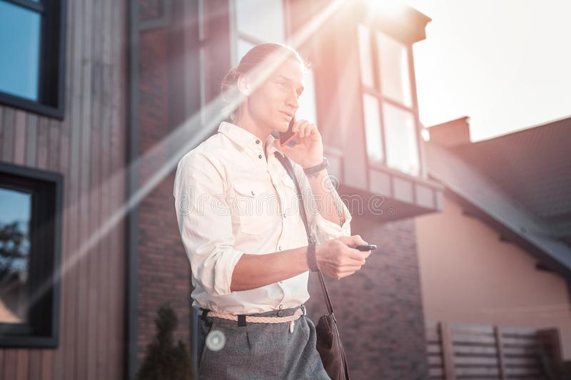 Stylish businessman feeling good going to work on warm summer day stock photography