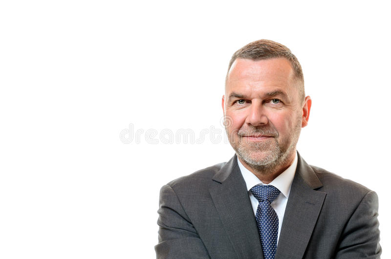 Stylish businessman with a friendly smile. Stylish middle-aged businessman with a short stubbly beard and a friendly smile in a head and shoulders portrait royalty free stock image