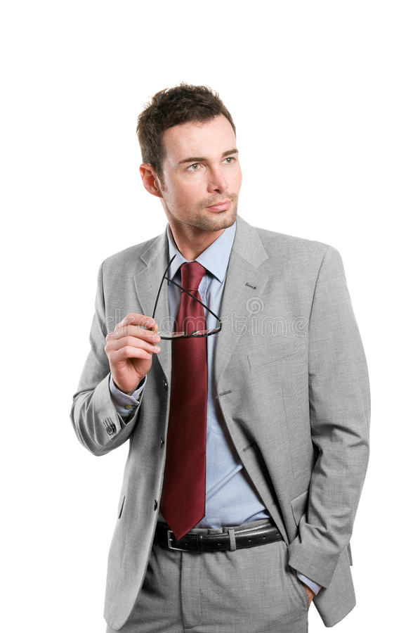 Stylish businessman looking away. Handsome stylish businessman with pair of glasses looking away isolated on white background stock photos