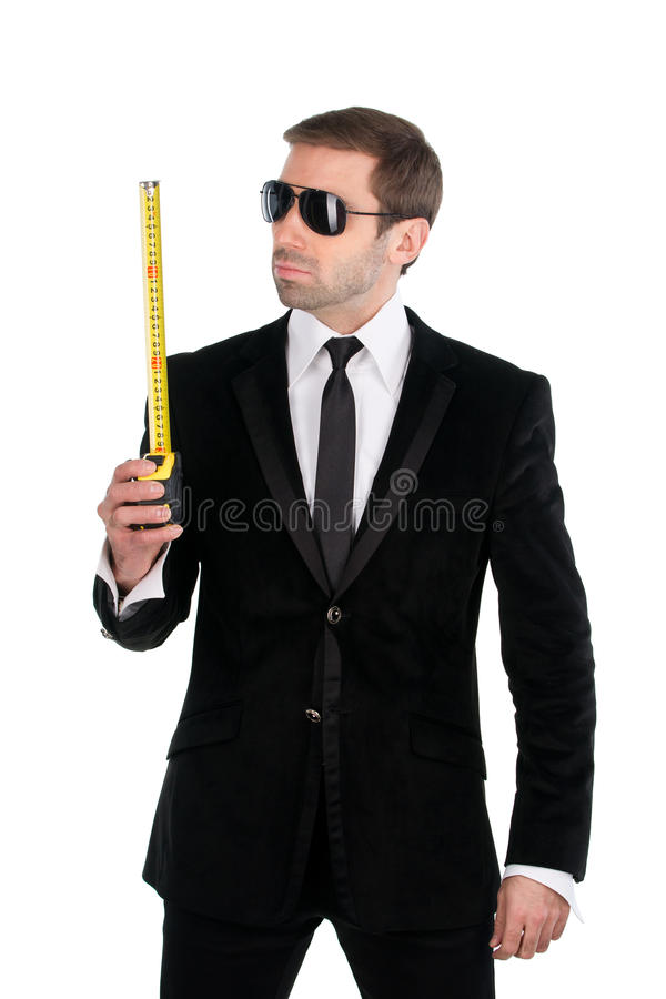 Stylish businessman in sunglasses with tape measure. Isolated on. White background stock images