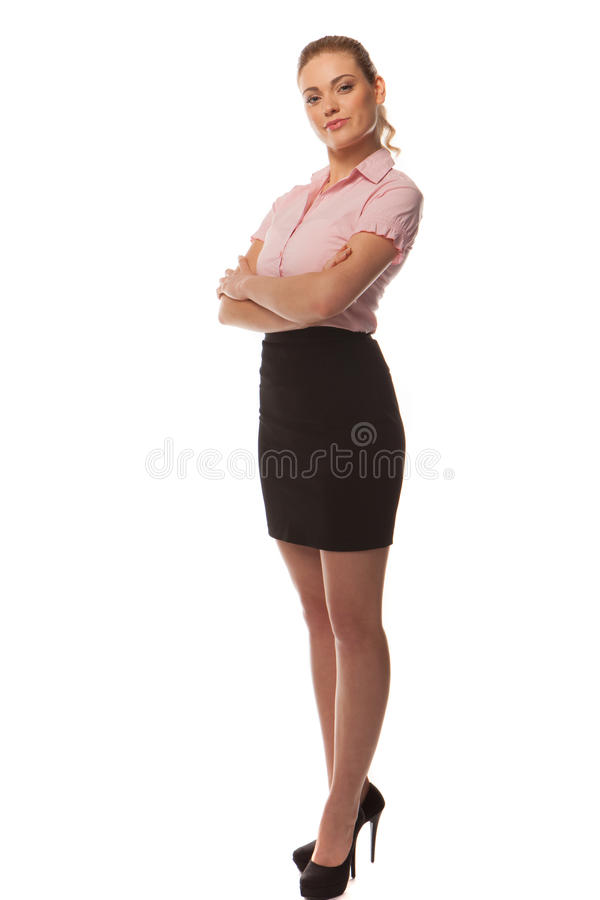 Stylish businesswoman in a summer outfit. And stillettoes posing with her arms crossed, full length portrait isolated on white stock photography