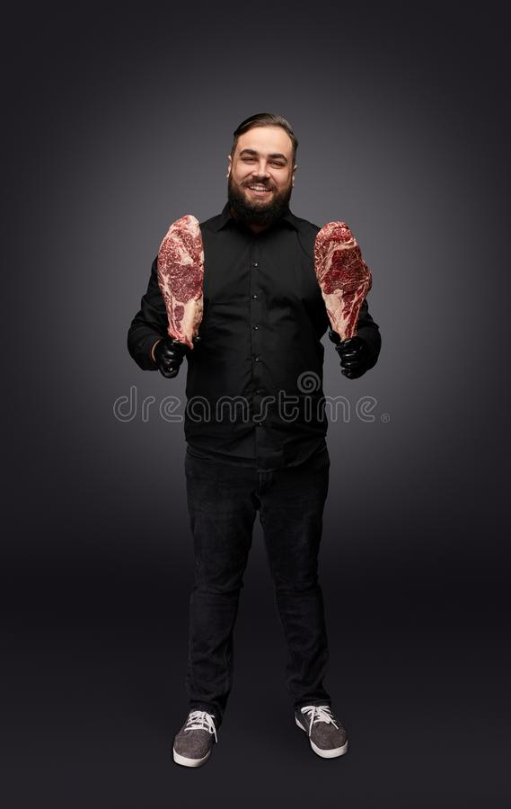 Stylish butcher posing with meat royalty free stock photos