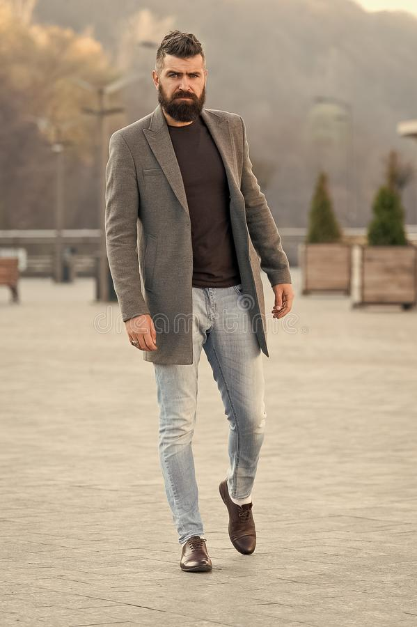 Stylish casual outfit spring season. Menswear and male fashion concept. Man bearded hipster stylish fashionable coat or. Jacket. Comfortable outfit. Hipster royalty free stock images